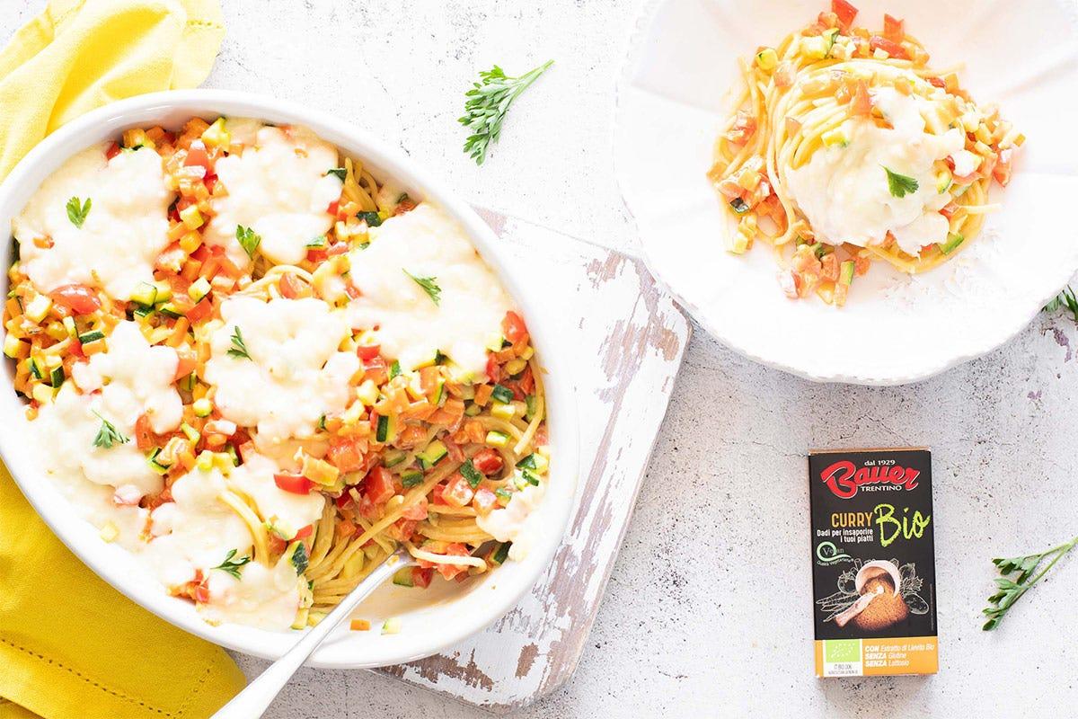 Spaghetti al curry con verdure, mozzarella, dado al curry bio Bauer Spaghetti al curry con verdure, mozzarella, dado al curry bio Bauer